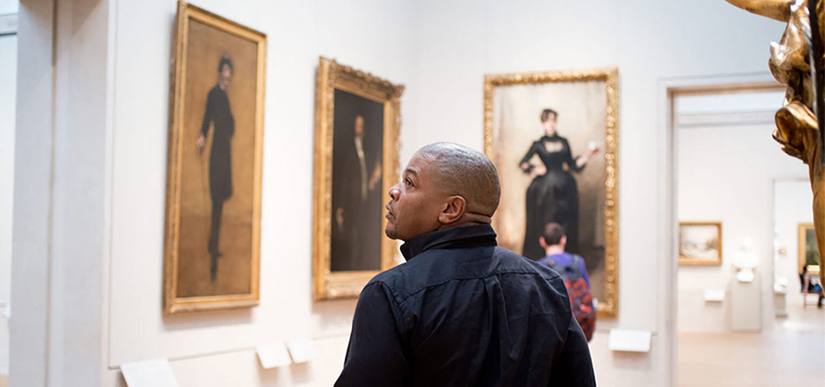 The artist Kehinde Wiley walks through a gallery of portraits by John Singer Sargent.