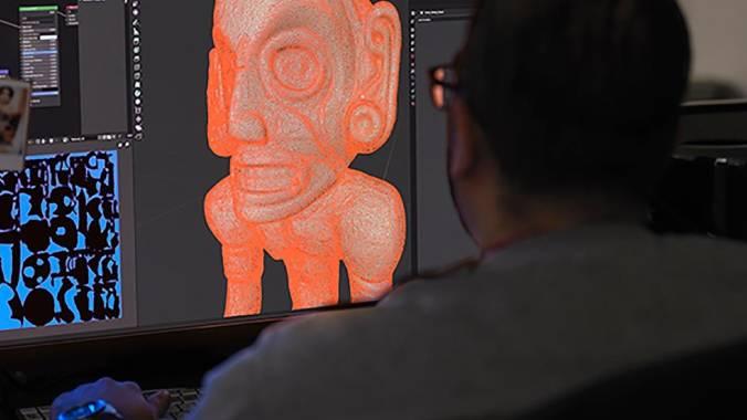 Imaging Production Manager Wilson Santiago works on an AR model of the zemí cohoba stand.