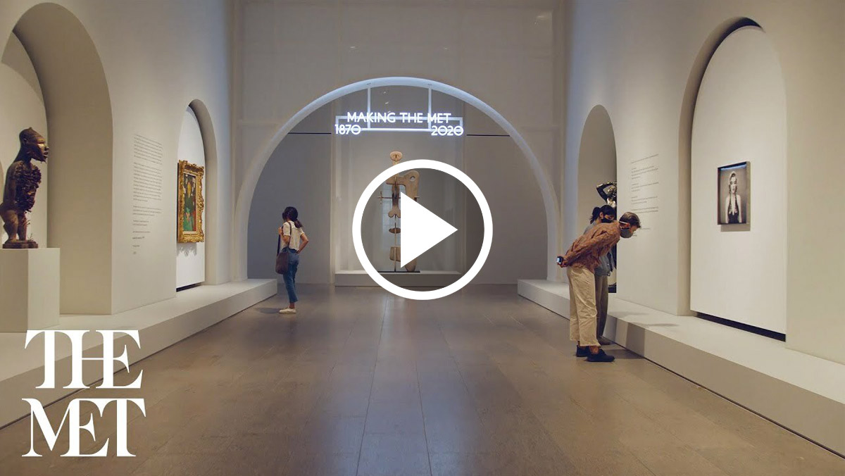 Three people looking at art in the galleries of Making The Met