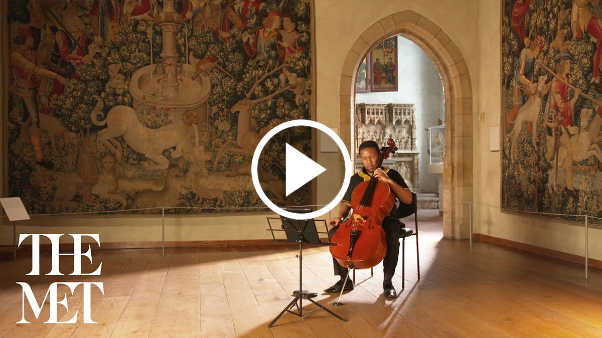 Thapelo Masita playing a cello at The Met Cloisters