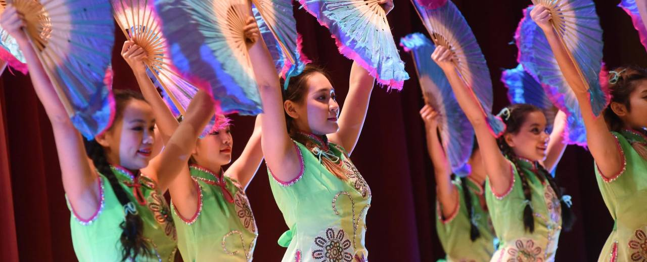 Dancers wave fans for the Lunar New Years