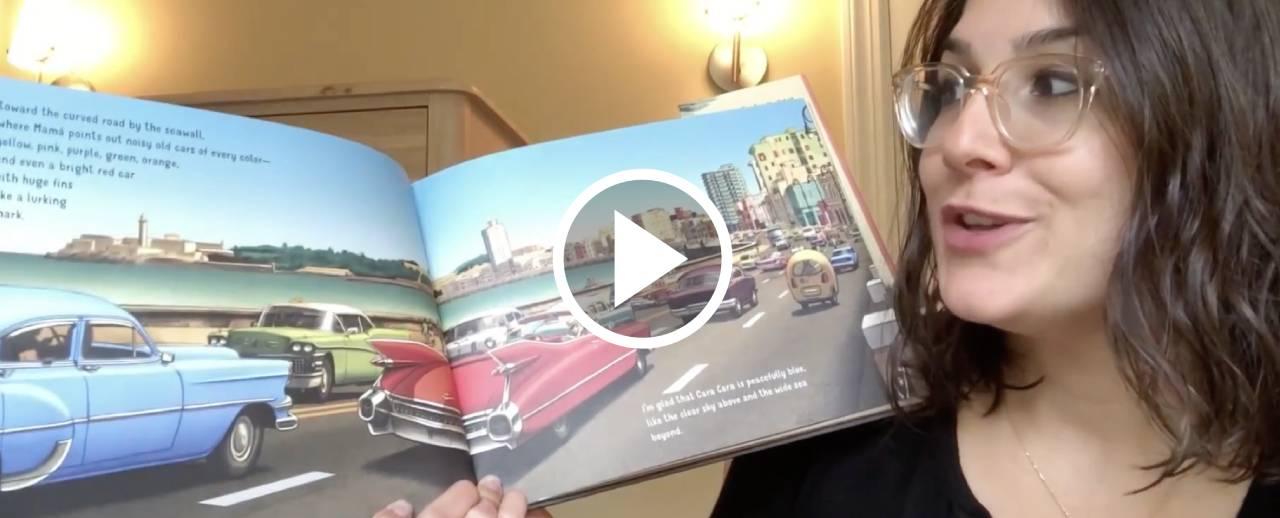 Met educator Christina reading 'All the Way to Havana' by Margarita Engle.
