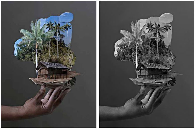 A print of an outreached hand holding up a cut-out scene of a structure amidst palm trees.
