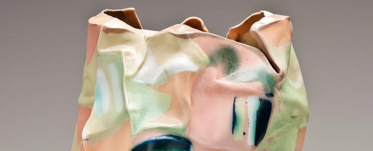 Colorful porcelain ceramic molded in a sensual vessel shape.