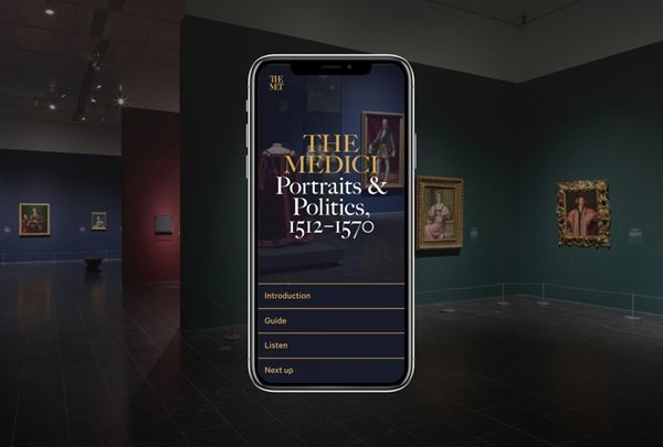 """An iPhone screen showing the in-gallery guide for """"The Medici"""" exhibition superimposed over a picture of a room from the exhibition"""