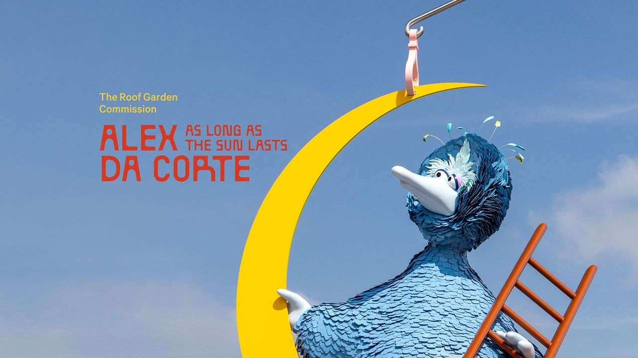 """Sesame's big blue bird sits atop a yellow half crescent moon while holding a red ladder with overlaid text, """"The Roof Garden Commission. Alex Da Corte As Long as the Sun Lasts"""""""
